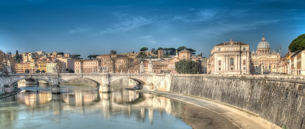 Panorama of rome, bridge on the river tiber to the basilica of st. peter