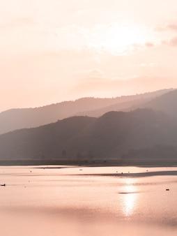 Panorama scene of lake mountain sunset.  landscape at dusk .beautiful sky at sunset in autumn . perfect mountains at sunrise and sunset time. beautiful scenery