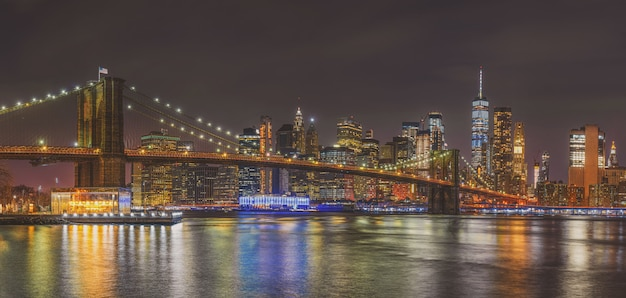 Panorama scene of new york cityscape with brooklyn bridge, usa