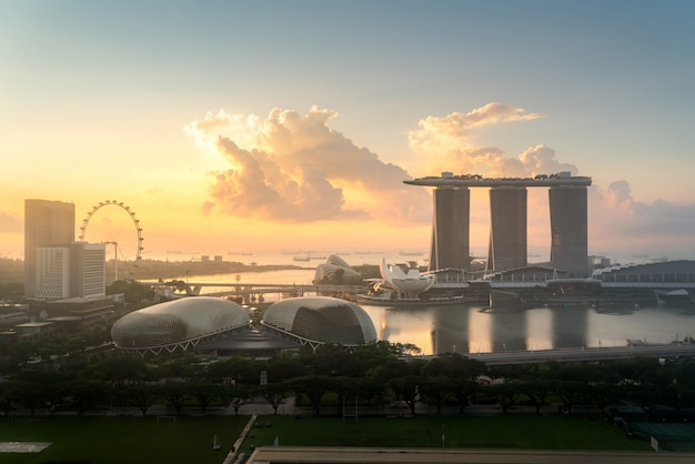Panorama of singapore business district skyline and office skyscraper during sunrise in marina bay
