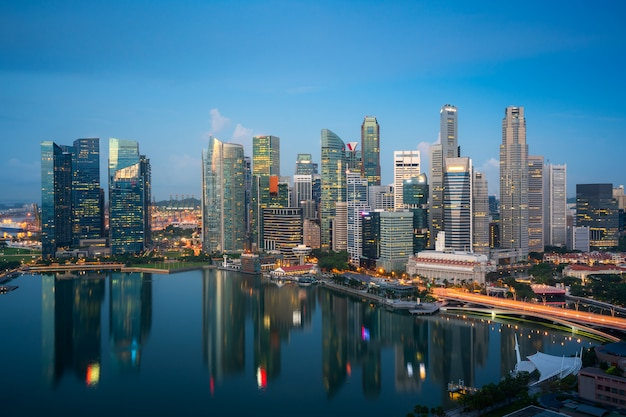 Panorama of singapore business district skyline and skyscraper at twilight night at marina bay, singapore. asian tourism, modern city life, or business finance and economy concept.