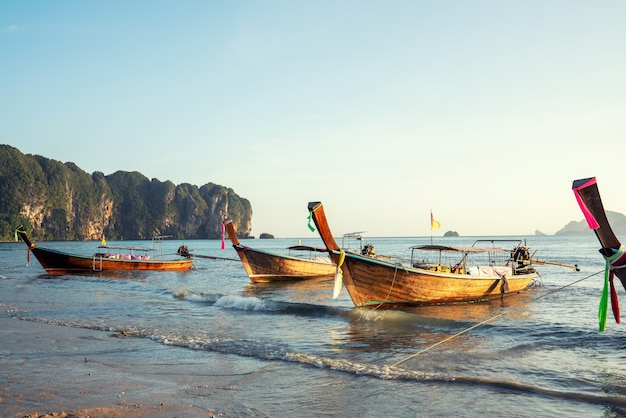 Panorama of traditional long tail boat on phi phi island, krabi, thailand in a summer day