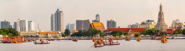 Panorama of traditional royal thai boat in river in bangkok city with wat arun temple