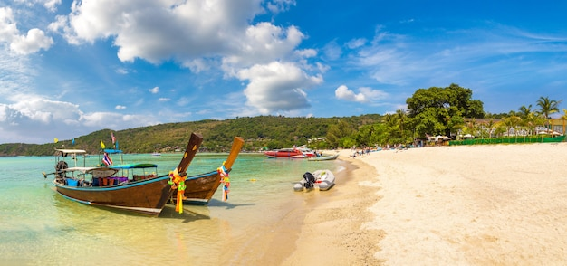 Panorama of traditional thai longtail boat on phi phi don island, thailand
