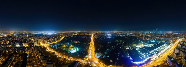 Panorama view of bucharest at night from the drone, multiple residential and commercial buildings, a lot of illuminationnd long exposure, romania