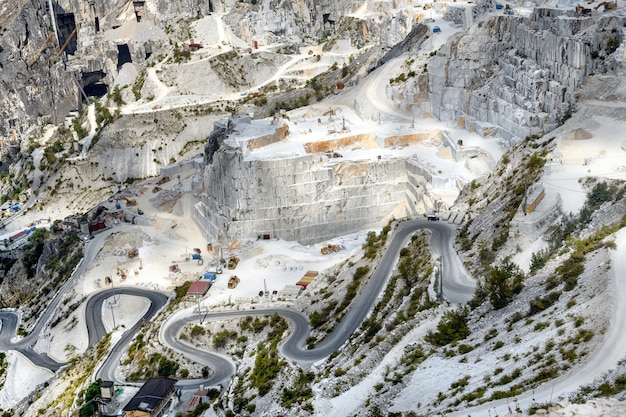Panorama view of carrara marble quarries in a steep mountain