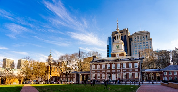 Panorama view of crowd and tourists at independence hall in sunny day and blue sky background.