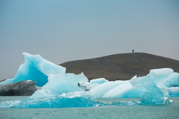 Panorama view of icebergs floating in jokulsarlon lagoon near the southern coast of iceland, travel destinations concept