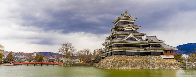 Panorama view of matsumoto castle (matsumoto-jo) and red bridge in eastern honshu