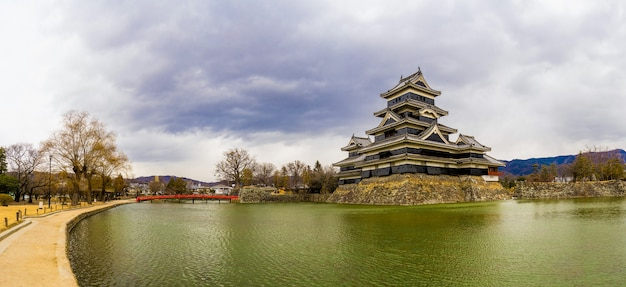 Panorama view of matsumoto castle (matsumoto-jo) and red bridge in easthern honshu