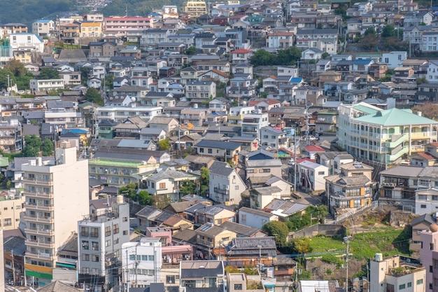 Panorama view of nagasaki city with montain and  blue sky background, cityscape, nagasaki, kyushu, japan