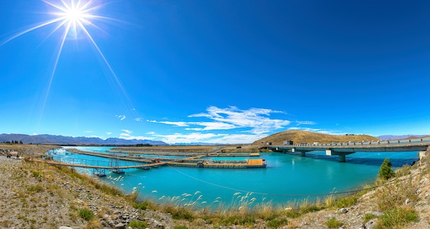 Panorama view of salmon fish farm , south island new zealand