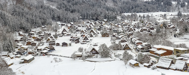 Panorama view of snow covered shirakawago village in winter from shiroyama viewpoint