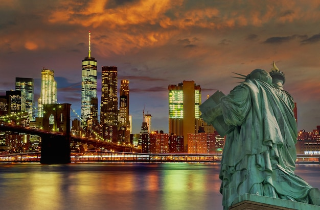 Panorama view of statue of liberty with manhattan downtown skyscraper in lower manhattan, new york city, usa