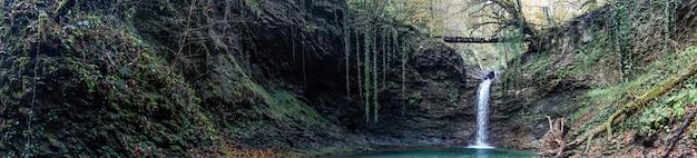 Panorama of waterfall azhek, hiking in forest of sochi, russia.