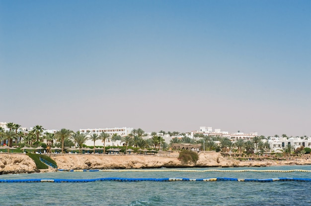Panorama of white city and the blue sea with a coast line.