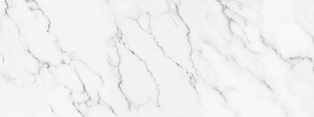 背景または豪華なタイルの床と壁紙の装飾的なデザインのためのパノラマの白い大理石の石のテクスチャ