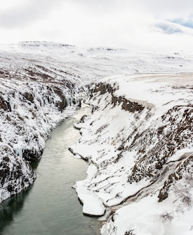 Panorama winter landscape, river and cliff at northern iceland