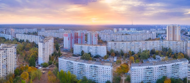 Panorama of the wonderful orange dawn with mauve sky on the cityscape with panel houses