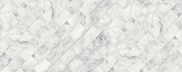 背景または豪華なタイルの床のパノラマホワイト大理石の石のテクスチャ