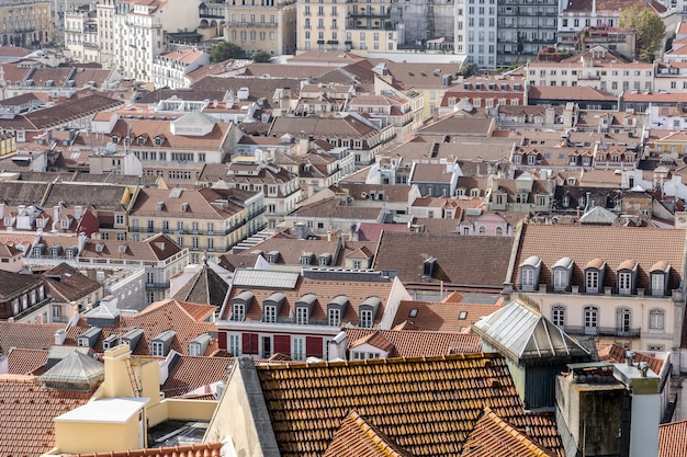 Panoramic aerial image of a lisbon town with red shingles covered roofs