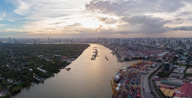 Panoramic aerial view over bangkok city with bangkok port.