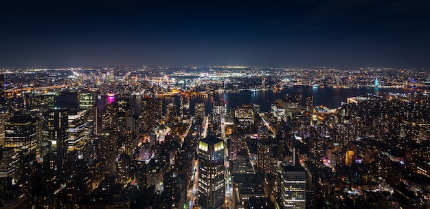 Panoramic aerial view of manhattan new york at night