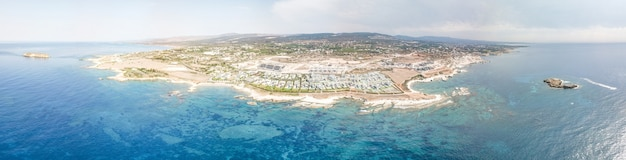 Panoramic aerial view of sea and beach near paphos in cyprus. bright sky and crystal water. cyprus