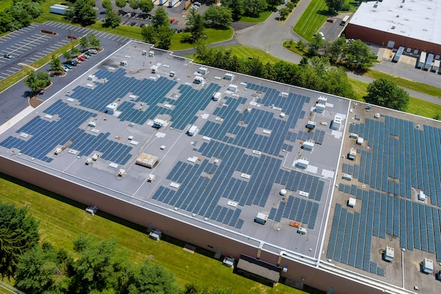 Panoramic aerial view solar panel energy on the an industrial warehouse rooftop