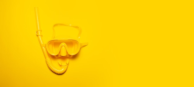 Panoramic banner view of yellow diving mask with snorkel, isolated on yellow