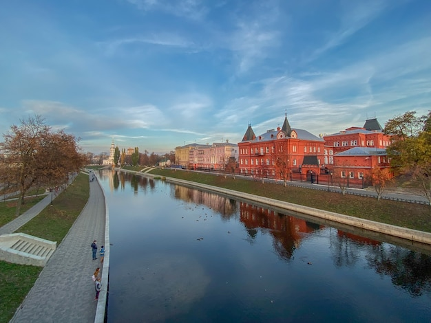 Panoramic city view of the river, promenade, old churches and buildings against the sky with clouds. horizontal orientation