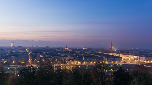 Panoramic cityscape of turin (torino) from above at dusk