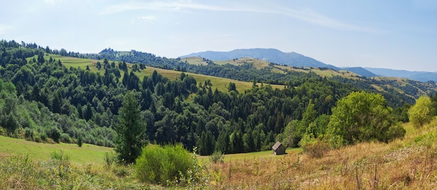 Panoramic landscape of mountains carpathians and wooden house.
