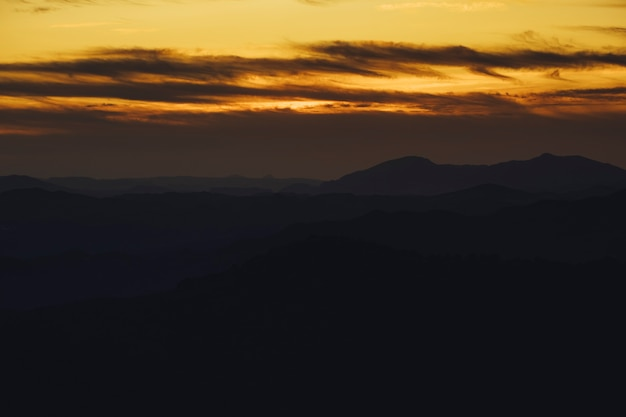 Panoramic mountain and dramatic sky sundown background in golden