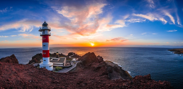 Panoramic in the orange sunset at the punta de teno lighthouse on the island of tenerife