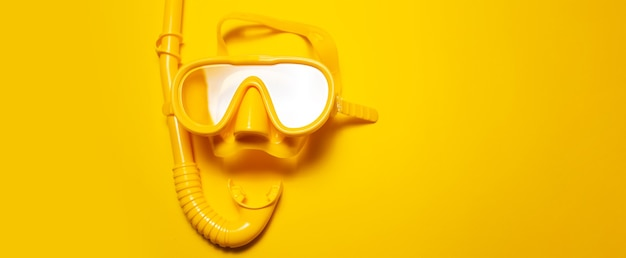 Panoramic photo of yellow diving mask with snorkel