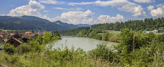Panoramic shot of a beautiful summer landscape with a river in slovenia
