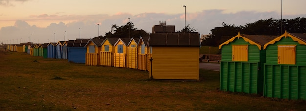 Panoramic shot of colorful lodges during sunset