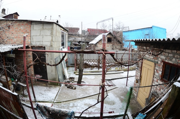 Panoramic shot of the old ukrainian courtyard with a house and a barn.