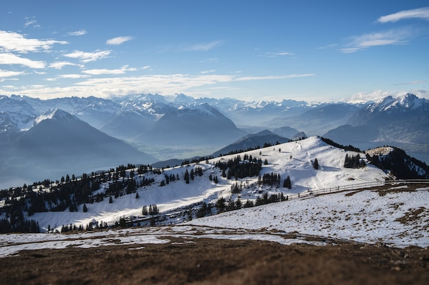 Panoramic shot of the rigi mountains in arth switzerland, under a blue sky during winter