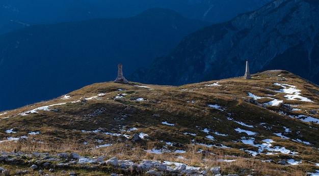 Panoramic shot of two stone constructions in the italian alps