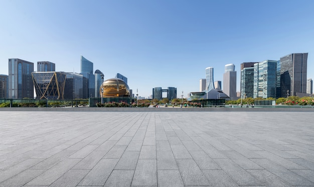 Panoramic skyline and buildings with empty concrete square floor in china