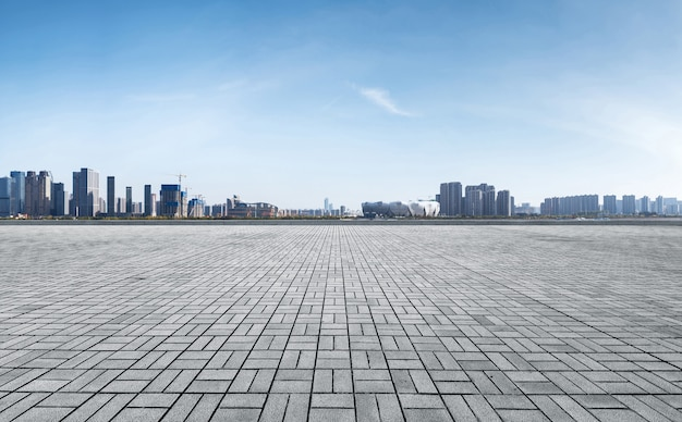 Panoramic skyline and buildings with empty concrete square floor, qianjiang new town