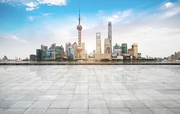 Panoramic skyline and buildings with empty concrete square floor,shanghai,china