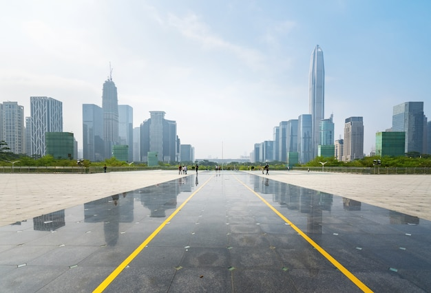 Panoramic skyline and buildings with empty concrete square floor in shenzhen,china