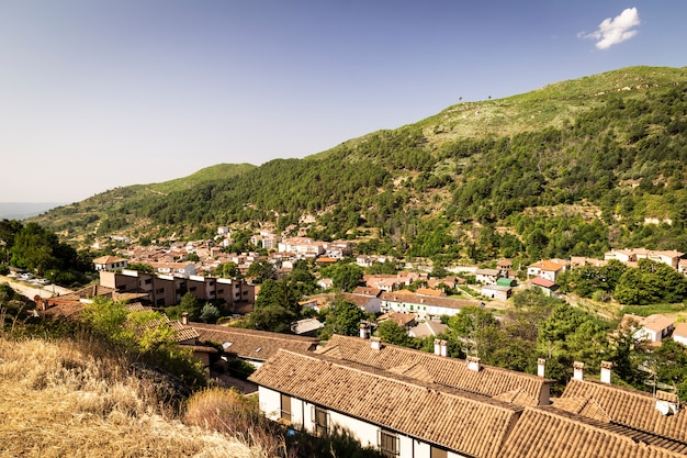 Panoramic of a small town at the foot of a mountain