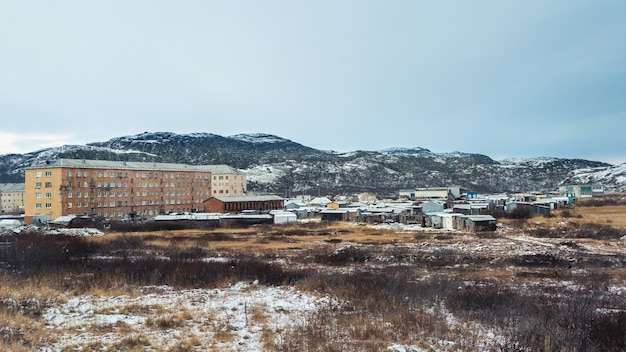 Panoramic view of arctic village lodeynoye on the shore of the barents sea