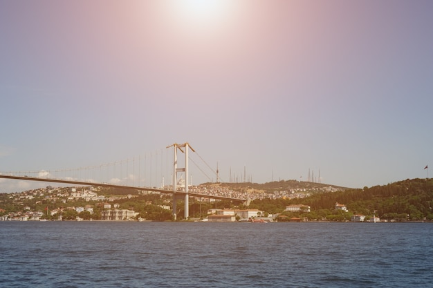 Panoramic view of the asian part of istanbul from the sea. the bridge of martyrs on july 15. sunlight.
