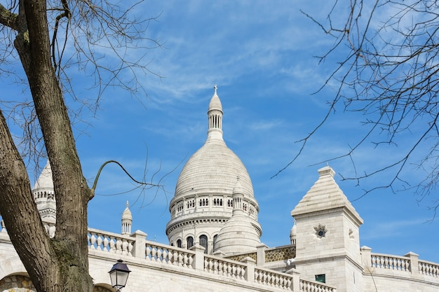 Panoramic view of basilica of the sacred heart of paris with blue cloudy sky in background