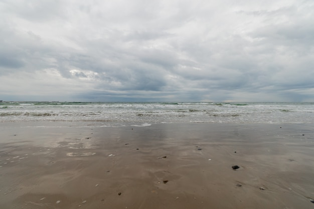 Panoramic view of the beach under the stormy sky